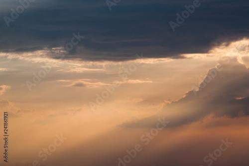 Photo  Sun rays through clouds like an dramatic explosion