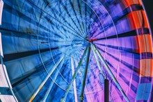 Bright Ferris Wheel In Motion....