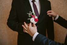 The Groomsman Friend Gives The Groom A Boutonniere. Concept Wedding Day. Wedding Preparation.