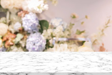 Abstract Blur Beautiful Flowers And Floral Background In Beauty Shop With White Marble Texture Perspective Counter For Promote And Show And Advertise Product On Display