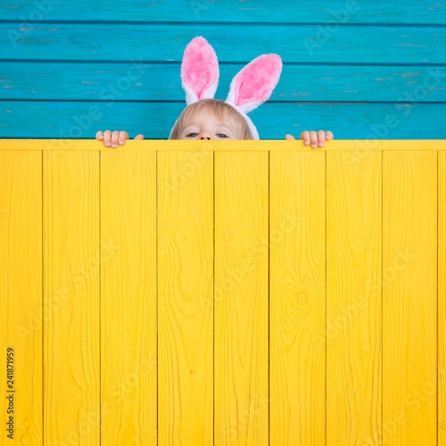 Funny kid wearing Easter bunny Wallpaper Mural