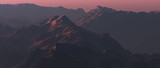 Rough steep mountains at sunset. - 241875108