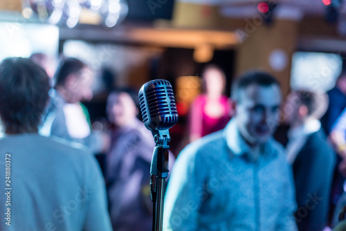 Retro microphone on stage in a pub or American Bar(restaurant) during a night sh Fototapeta