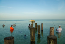 Peoples Fishing At Old Naples Pier, Florida
