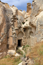 The Inconspicuous Entrance To The Old Ancient Cave Temple In The Mountain Valley Of Cappadocia