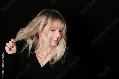 Fotografie, Obraz  Woman With Rooty Blonde Modern Shag Haircut