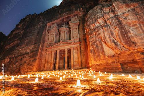 Fotomural Petra by night, Treasury ancient architecture in canyon, Petra in Jordan