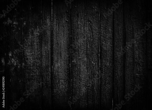 Valokuva  dark background of old black wooden boards