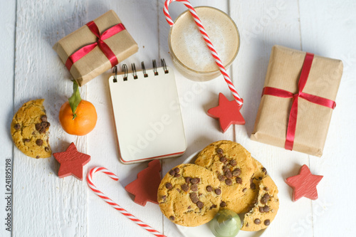 Flat lay composition with Christmas cookies, decor and cocoa on the white table