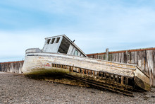 A Wrecked Boat On The Shore Ne...