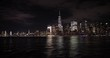 New York City night skyline buildings from sailing boat