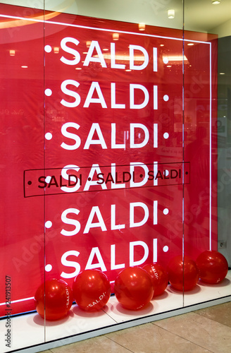 Fotografie, Obraz the window of an Italian shop, with a big red sign and balloons with the word sale repeated many times