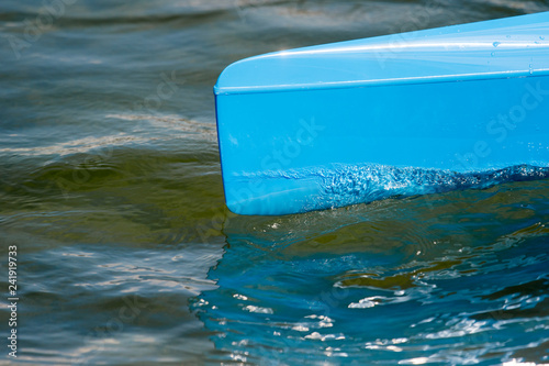 Fotografie, Obraz  Blue canoe, kajak and rowing on lake water.