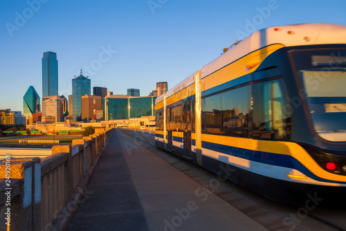 Moving streetcar on the Houston Street Viaduct with the city of Dallas in background. The Dallas Streetcar is a 2.tif