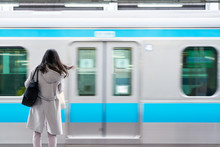 Business Woman With Blur Train