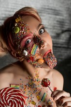 Girl With Sweets And Caramel On Her Face Shot