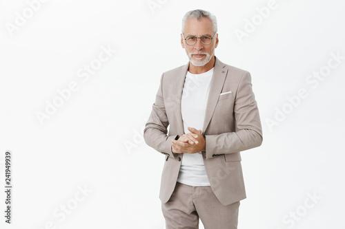 Fotografia Portrait of smart and handsome intelligent senior male professor in stylish suit