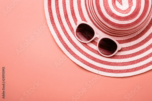 Obraz Female striped summer romantic Hat On Living coral background. Concept of summer holidays - fototapety do salonu