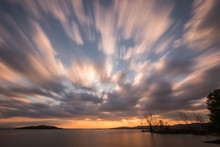 Beautiful Wide Angle, Long Exposure View Of A Lake At Sunset, With An Huge Sky With Moving Clouds