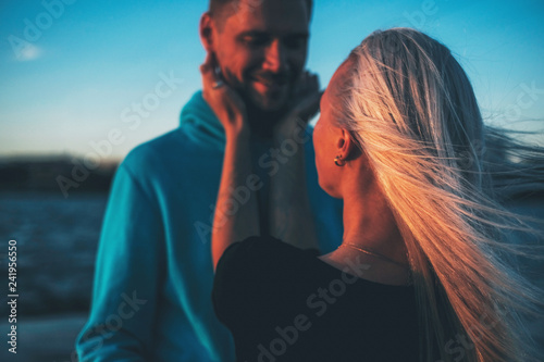 Fototapety, obrazy: Couple in love on the pier, sunset time, water background