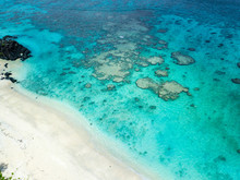 An Aerial View Of Black Rock Beach In Rarotonga In The Cook Islands