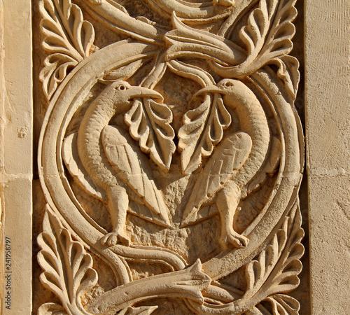 uccelli con tralci e foglie; stipite del portale  della Basilica di Santa Cateri Wallpaper Mural