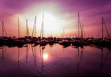 Beautiful View Of Marina And Harbor With Yachts And Motorboats. Sunset At The Ocean.