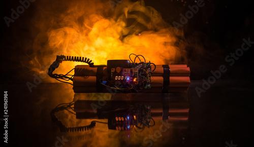 Fotografia  Image of a time bomb against dark background