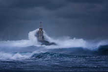 Big Wave Against Old Lighthous...