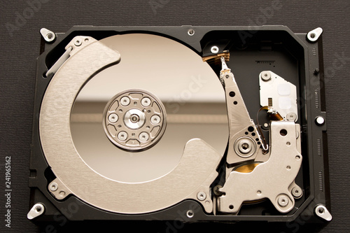 Fotografía  Disassembled hard drive . Isolated on black background.