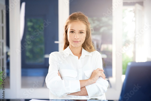 Fototapety, obrazy: Beautiful young businesswoman portrait while sitting in the office