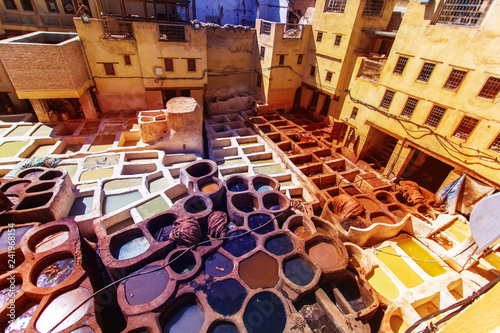 Fotomural  Tanneries of Fes Morocco, Africa Old tanks of the Fez's tanneries with color pai