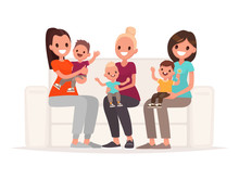 Moms Are Holding Babies In Their Arms While Sitting On The Sofa. Communication Of Young Mothers