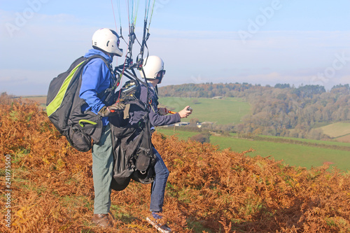 Tandem paraglider preparing to launch - Buy this stock photo and