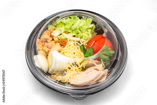 Fresh chicken salad in a plastic package to take away for lunch on white background