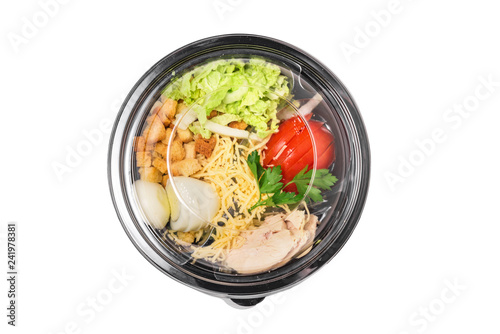 Healthy salad caesar in plastic package for take away or food delivery isolated on a white background