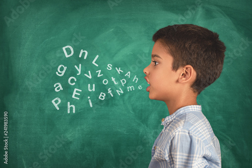 Foto Child speaking and alphabet letters coming out of his mouth