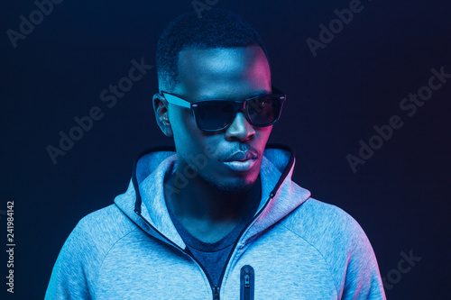 Fotografie, Obraz  Close-up portrait of stylish black man, wearing hoodie and sunglasses