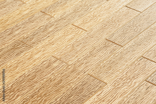 Fotografering  surface from joined wooden planks with dark wavy pattern