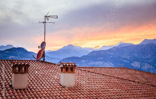 Canvas-taulu TV Antenna on the roof of an Italian house, Sunset