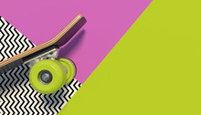 Wooden Skateboard With Bright Colored Wheels On A Colorful Background With Geometric Patterns. Copy Space. Minimalistic Creative Concept. 3D Render.