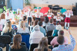 Children's holiday in kindergarten. Children on stage perform in front of parents. image of blur kid 's show on stage at school , for background usage. Blurry.