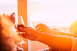 canvas print picture - Close up of group of friends toasting and clinking glasses with beer and wine all together in friendship celebrating - sunset and sun in backlight summer image concept for happy and fun in friendship