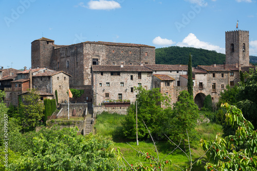 Spoed Foto op Canvas Historisch geb. Castle of Santa Pau in summer day, Garrotxa