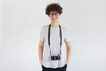 Smiling Female Photographer With Retro Film Photo Camera, Standing Isolated On Gray Background