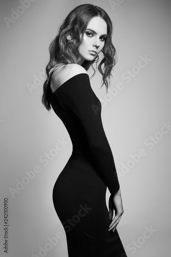 Tuinposter womenART Fashion portrait of young lady in black dress