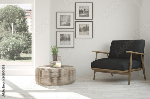 Fotografia Idea of white room with armchair and summer landscape in window