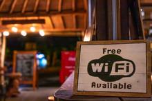 Free Wifi Sign Wooden Board In Restaurant Of Bali Island, Indonesia.
