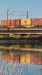 Smartphone HD wallpaper of beautiful reflections with driving train at the Isarbridge Plattling