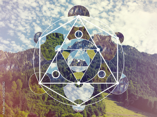 Carta da parati Collage with the mountains and forest and the sacred geometry symbol